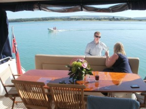 Guests enjoying a relaxing lunch at Anchor on board a Princess 65 in Newtown Creek on the Isle of Wight
