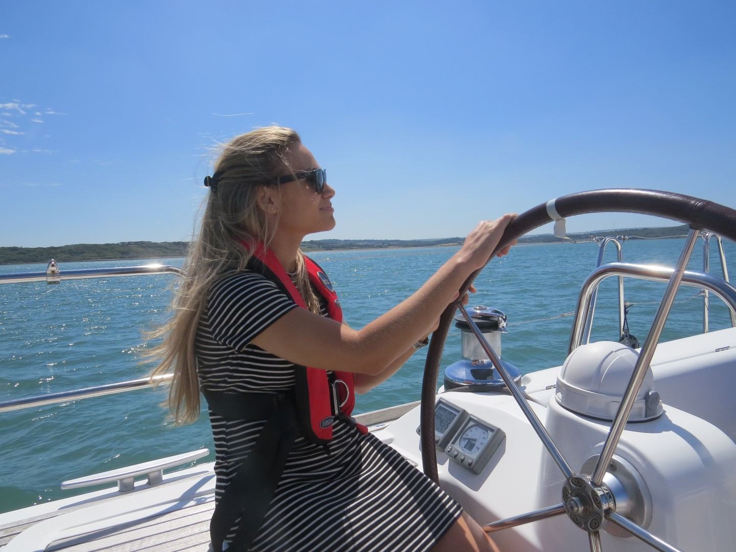 guest relaxing on the helm, company sailing day